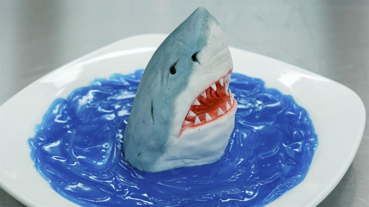 Ashley makes killer cakes that jump off the plate at a Shark Week party.