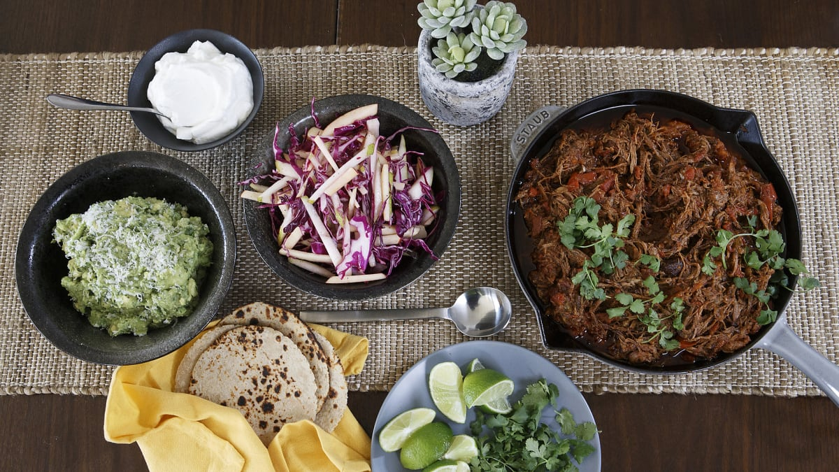 Dan makes pulled brisket tacos topped with a variety of fresh ingredients.